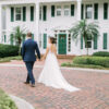 bride and groom walking near Cypress Grove Estate House