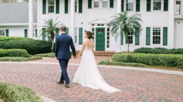 bride and groom walking near Cypress Grove Estate House